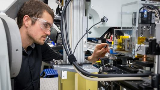Argonne materials scientist Andrew Ulvestad examines a sample at Argonne's Advanced Photon Source.