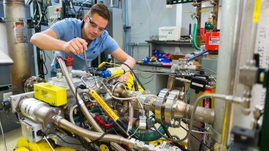 Pictured is Argonne researcher Michael Pamminger working on a test engine that will be used as part of the TPS-Argonne collaboration.