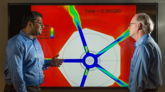 Argonne researchers Sibendu Som and Raymond Bair review fuel spray simulations at the Argonne Leadership Computing Facility. Som and Bair were honored for their work by the Federal Laboratory Consortium.