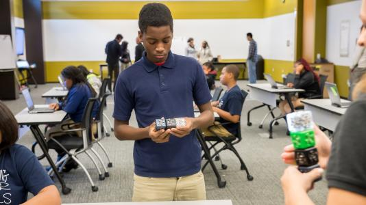 A student from from Chicago's Laura S. Ward STEM School learning to use computational thinking.
