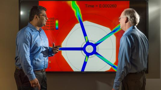 Sibendu Som (left) and computational scientist Raymond Bair discuss combustion engine simulations conducted on Argonne's Mira supercomputer, with the aim of gaining further insight into the inner workings of combustion engines.