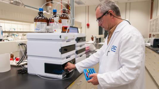 Chemical purity is a crucial parameter for battery-grade materials. Argonne chemist Kris Pupek loads a sample onto a high-performance liquid chromatography instrument in the Materials Engineering Research Facility's process research and development lab. This instrument separates and analyzes the components of a sample to measure and identify impurities. Photo courtesy Argonne National Laboratory. 30147D19