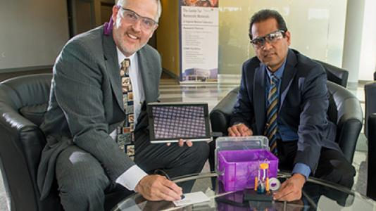 """University of Wisconsin-Stevens Point chemistry professor Michael Zach (left) and Argonne nanoscientist Ani Sumant pose with their R&D 100 award-winning """"NanoFab lab…in a box!"""""""