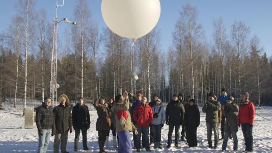 Members of the AMF2 launch team and scientists from the University of Helsinki and the Finnish Meteorological Institute launch a weather balloon at the kickoff meeting in Hyytiälä, Finland. The mobile facility will take climate data in Hyytiälä for eight months to study, among other things, how the boreal forest interacts with the atmosphere.