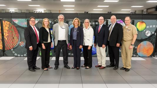 While visiting Argonne, Under Secretary Gordon-Hagerty toured the Advanced Leadership Computing Facility, which is the future home of Aurora, set to be the nation's first exascale system. From left to right: Keith Bradley, Megan Clifford, Mike Papka, Lisa E. Gordon-Hagerty, Joanna Livengood, Pete Hanlon, John Stevens and Christopher Osborn. (Image by Argonne National Laboratory.)