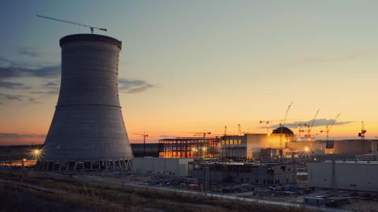 nuclear reactor in foreground at sunset