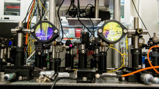 Argonne senior scientist David Awschalom is collaborating with the University of Chicago and Fermilab on an ambitious project to link the two U.S. national laboratories. Awschalom is shown in reflection on the right in his lab at the University.