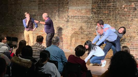 "Members of an improv troupe — made up of scientists including Argonne's own James Dolan, a postdoctoral researcher at the Institute for Molecular Engineering — performed in a production called ""The Excited State"" at Hyde Park's Revival Theater in October. (Image courtesy of James Dolan/Argonne National Laboratory.)"
