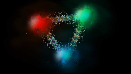 Argonne is working with other DOE national laboratories on the planned Electron Ion Collider, which will probe  how subatomic quarks (shown here in red, blue and green) interact through the exchange of gluons (shown as  wiggly helices). (Image courtesy of Shutterstock.)
