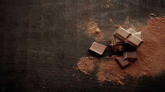 Scientists at Argonne have used an X-ray technique to discover the properties of chocolate's microstructure that contribute to a pleasing mouthfeel. (Image by Shutterstock / Africa Studio.)