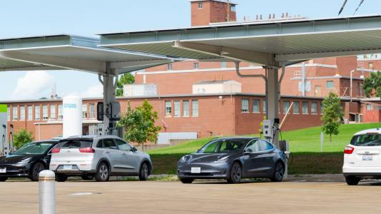 Electric vehicles at vehicle charging stations.