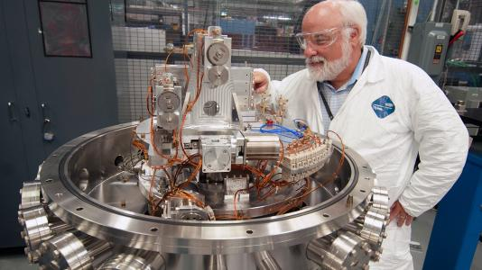 Senior Research Associate Tim Graber tests a monochromator designed for use with the upgraded Advanced Photon Source. The monochromator is now operating at the 2-ID beamline.