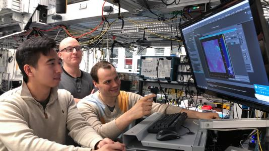Scientists Kevin Miao, Chris Anderson and Alexandre Bourassa work on quantum research in the Awschalom lab at the University of Chicago's Pritzker School of Molecular Engineering. (Image by David Awschalom.)