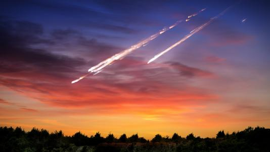 Artist's representation of meteorites falling to Earth. A team of researchers recently shed light on how meteorite strikes may affect quartz, one of the most abundant materials in the Earth's crust. (Image by Shutterstock/Triff/NASA.)