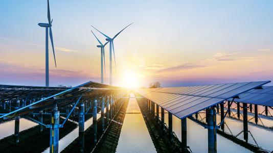 DIS-GEST Leadership banner-wind turbines and solar panels