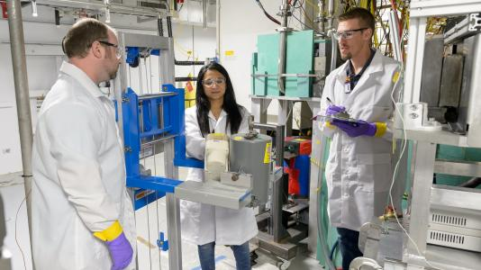 Scientists standing in laboratory. (Image by Argonne National Laboratory.)