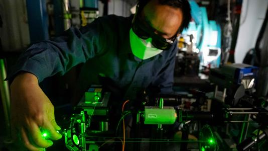 Photograph of man working with equipment. (Image by Argonne National Laboratory.)