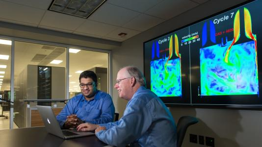 Argonne mechanical engineer Sibendu Som and computational scientist Raymond Bair discuss combustion engine simulations conducted by researchers using the CONVERGE code at the Virtual Engine Research Institute and Fuels Initiative (VERIFI).