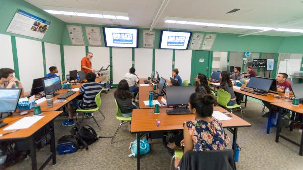 Michael Papka (left) help lead Argonne's first Big Data and Visualization Camp over the summer. He taught these high schoolers the importance of extracting useful information from an increasingly vast sea of numerical data. (Image by Argonne National Laboratory.)