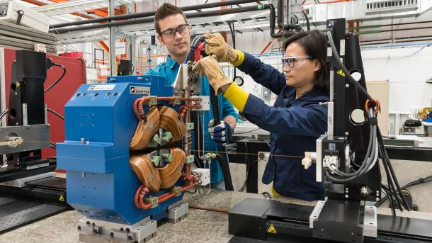 APS employees work to adjust a magnet that will be used in the APS Upgrade. (Image by Argonne National Laboratory.)