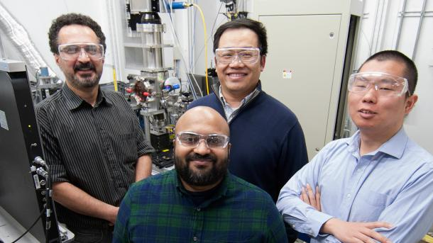 Argonne scientists who were co-authors on a recent paper about the 3D manufacturing process pose inside a hutch at Argonne's Advanced Photon Source, in front of a specialty system that can simulate the Laser Powder Bed Fusion Process in a commercial 3D printer. Pictured, from top left, are Kamel Fezzaa, an APS beamline scientist; Tao Sun, an APS beamline scientist; Cang Zhao, an APS postdoc, and Niranjan Parab, an APS postdoc. (Image by Argonne National Laboratory.)