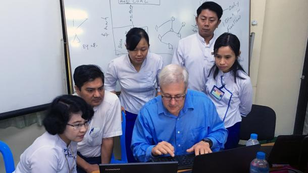 Argonne National Laboratory's Tom Veselka (center, in blue shirt) demonstrates use of GTMax during a training class in Southeast Asia.