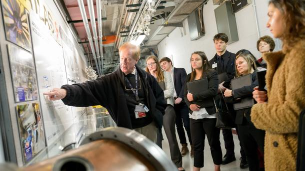Students listen attentively as their guide explains the complex and groundbreaking research at the Argonne Tandem Linac Accelerator System (ATLAS). (Image by Argonne National Laboratory.)