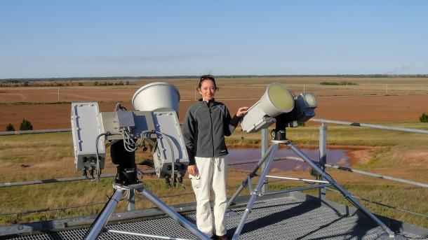 Cadeddu standing by equipment on open field.