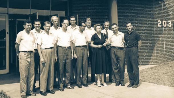 11 men and one woman in front of buidling. (Image by Argonne National Laboratory.)