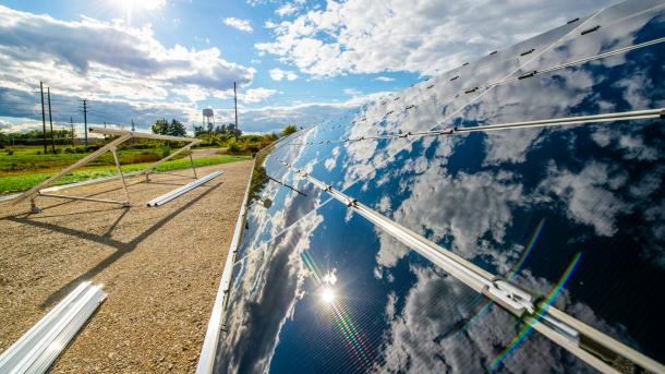 Mirror image of clouds next to roadway construction. (Image by Argonne National Laboratory.)