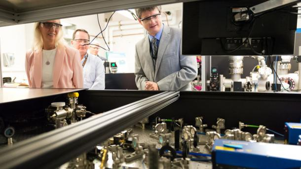 People look at equipment used to conduct physics research