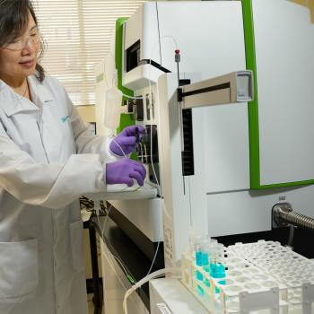 Analytical Chemist Yifen Tsai prepares a sample for analysis on the high-resolution ICP-Mass Spectrometer.